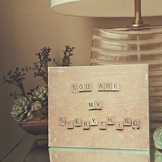Christmas gift for momo. Scrabble letters to spell a family quote on canvas