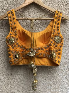 Gold sequins work blouse, with gold net lehenga with raw silk underlay teamed with net dupatta with butis and bugul work border. Designer Bridal Lehenga, Bridal Lehenga Choli, Net Lehenga, Gold Lehenga, Yellow Lehenga, Saree Blouse Neck Designs, Lehenga Designs, Lehnga Blouse, Stylish Blouse Design