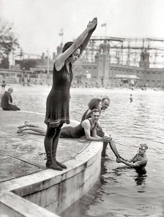 "Starlight Park, the Bronx, ca. 1921 // This photograph showcases a variety of swimming costumes from the early The young girl wears a wool swim dress with stockings and lace-up shoes known as ""beach boots"". Images Vintage, Vintage Pictures, Vintage Photographs, Old Pictures, Old Photos, Vintage Ads, Photographie New York, Shorpy Historical Photos, Foto Poster"