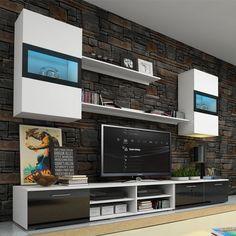 Vous allez faire des envieux avec cet ensemble TV OMEGA ! Très design il s'intègrera aussi bien dans un loft de style industriel que dans une villa ultra contemporaine. Vous disposez de deux meubles tv bas pour une largeur totale de 2m50 et donc un maximum de rangement ! Ils sont accompagnés de deux étagères murales et deux placards suspendus avec vitrines à éclairage leds.