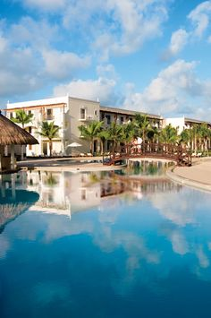 Newly-built free-form pool at Dreams Tulum with the Manatees Swim-Up Bar.