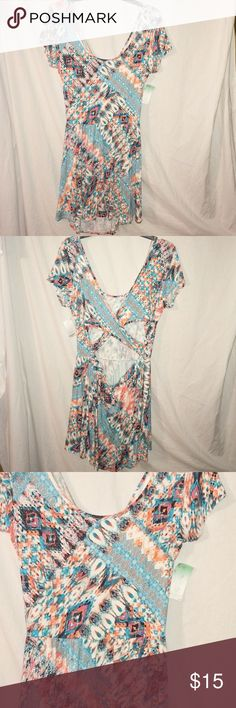 ❤️NEW LISTING❤️NWT! Beautiful Size XL Skater Dress This is a Southwestern Print Skater Dress with Beautiful Colors and a cut out Criss cross Back.  It's size XL and BRAND NEW with TAGS. Decree Dresses