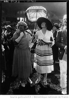 Next time we go to a garden party you get the umbrella and sun hat, I'll take the bad attitude and long gloves.  (Modes à Deauville le 8 août 1920)