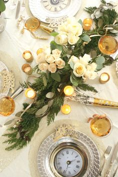 New Year's Eve is around the corner! Today I've put together my dream New Years' Eve tablescape by using some of my favorite vintage heirlooms and some new sparkly accents. Winter evergreens layered diagonally down the center of this round table add the perfect foundation for the white roses and gittery gold votives that add a hint of glamour.