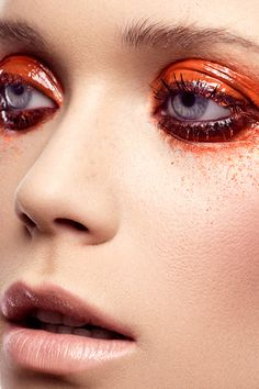 Glossy eyes, matte face. This is AMAZING. Color, creative, edgy, wet. I love the balance of wet/gloss and matte skin.