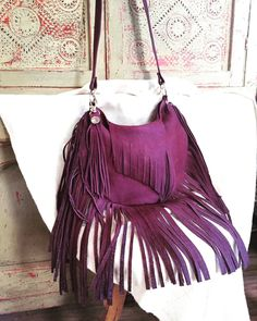 A personal favorite from my Etsy shop https://www.etsy.com/listing/262521611/plum-leather-fringe-handbag-bohohippy