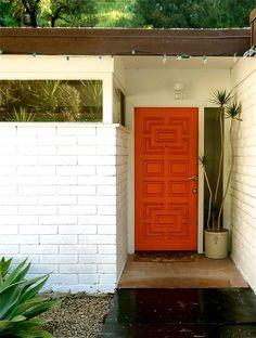 Crayola orange door + jungle green plants = perfect. (found via ascotfriday.typepad.com)