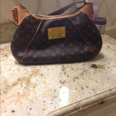 Louis Vuitton purse price firm no trades Definitely used condition patina but no rips and piping is good no trades price is firm I have receipt I'm original owner Louis Vuitton Bags