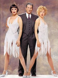 """Richard Gere, Renee Zellweger and Catherine Zeta-Jones in costumes they wore in """"Chicago"""" designed by Colleen Atwood, for a look. Colleen Atwood, Catherine Zeta Jones, Chicago Movie, Chicago Musical, Theatre Costumes, Movie Costumes, Estilo Charleston, Chicago Costume, Retro Mode"""