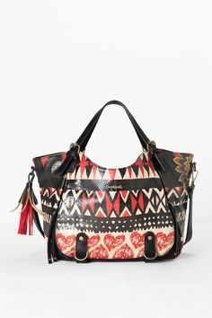 This trapezium bag measures 31 x 15 x 30 cm and has 2 exterior and 3 interior pockets. It's made of soft, snake effect faux leather with premium finishes and a print that highlights your love for all things ethnic.