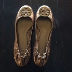 Tory Burch gold Reva flats size 10 Tory Burch gold Reva flats size 10- only worn a couple times, no scuffs, tears, stains etc. gold hardware. Size 10 but feels slightly smaller than my other 10s but I haven't worn them enough to break in like my others and I probably forgot what they feel like at first. Tory Burch Shoes Flats & Loafers