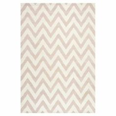 Highlight your living room or master suite in eye-catching style with this hand-tufted wool rug, featuring a bold chevron motif.  Product: RugConstruction Material: 100% WoolColor: Light pink and ivoryFeatures:  Hand-tuftedLoop textureNote: Please be aware that actual colors may vary from those shown on your screen. Accent rugs may also not show the entire pattern that the corresponding area rugs have.Cleaning and Care: Professional cleaning recommended