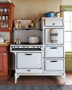This 1932 Magic Chef stove looks gorgeous inside an old farmhouse kitchen.