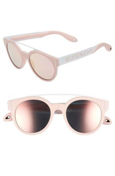 ecc725272e3 These are women s green pink red round sunglasses from Givenchy
