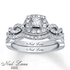 Absolutely in love with this ring  This stunning bridal set from the Neil Lane Bridal® collection features a sparkling princess-cut diamond within a halo of round diamonds. Additional round diamonds line the ring and the matching wedding band, bringing the total diamond weight to 3/4 carat. The bridal set is fashioned in 14K white gold. Each Neil Lane Bridal® diamond ring is hand-crafted and undergoes a four-step polishing process, which gives the ring its beautiful shine and luster.