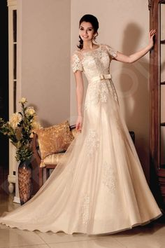 This elegant French-style wedding gown is sure to put everyone in awe.  Its stunning cut amplifies your feminine curves, and the long skirt with a train visually lengthens your silhouette. The corset with lace embroidering and bolero is the most exquisite, and the satin sash with a bow detail adds a coquette touch.  Become the embodiment of style in this gorgeous gown.  * Bolero is included in the price.  ** Other accessories are not included in the price.