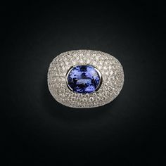 Impressive White Gold Ring Centering an Oval-Shape Tanzanite. Oval Shape, White Gold Rings, Cocktail Rings, Sapphire, Passion, Shapes, Jewels, Design, White Gold Wedding Rings