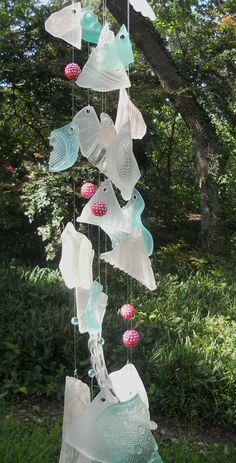 Glass wind chime in pink, teal & white w/ Lampwork glass beads. Pink, teal, and frosted white glass pieces were tumbled and combined with Lampwork glass beads to create this one of a kind wind chime. The pink glass has a raised hobnail pattern and the teal glass is patterned and translucent. The frosted white glass has a variety of raised patterns including hobnails. All of the glass was tumbled to remove sharp edges and create an alternative to sea or beach glass. The glass beads are…