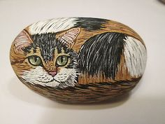 Calico-Tortoiseshell-Cat-hand-painted-on-a-stone-pet-rock-by-Ann-Kelly