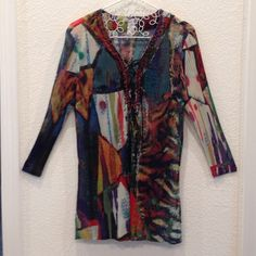 """Lace-Up Stretch Tunic Top Alberto Makali Semi-sheer stretch knit fortuny pleated tunic top with embroidered neckline and lace-up décolletage front. Alberto Makali, Size L. 95% polyester, 5% spandex. 29"""" long. Excellent condition. Snaps at shoulder seam for camisole. Alberto Makali Tops Tunics"""
