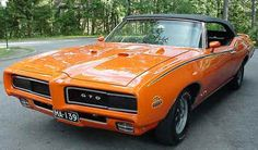 Pontiac GTO the Judge. Had a 1970 Bronze GTO, tach on the hood. Kenny Royster drove the Judge around Bethesda, MD.