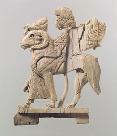Openwork plaque with ram-headed sphinx  Period: Neo-Assyrian  Date: ca. 9th–8th century B.C.  Geography: Syria, probably from Arslan Tash (ancient Hadatu)  Culture: Assyrian  Medium: Ivory