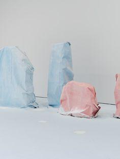 Karla Black, Foreground: Don't Need To Say, 2014, Polystyrene, sugar paper, chalk, and glue, 83.8 x 128.3 x 80 cm - Background: What's Taken, 2014, Polystyrene, sugar paper, chalk, and glue, 186.7 x 95.3 x 76.2 cm