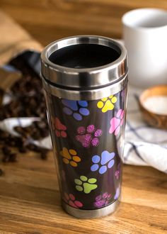 Is your affection colored by the paw prints that brighten your life? Why stop once you leave the house -- take your love out on the road! With billions of paper cups being tossed into landfills each year, feel good about doing something healthy for the planet by bringing a reusable cup. This travel mug features double-walled insulation to keep your beverage temperature-controlled longer.