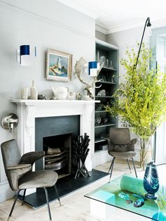 The front sitting room of Faye Toogood's London house contains a pair of Italian chairs, vintage Swedish lights above the fireplace and a vase by Hilda Hellstrom on the Element coffee table, designed by Toogood. My Living Room, Home And Living, Living Spaces, Style At Home, Casa Hipster, Room Inspiration, Interior Inspiration, Georgian Interiors, Turbulence Deco