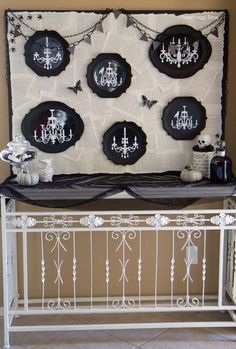 DIY Halloween display on iheartnaptime.net made from a foam board, book pages and plates from Target. Love this!