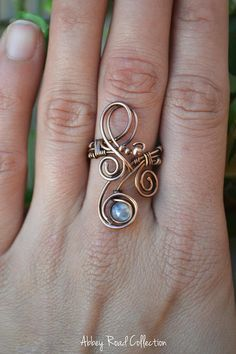 Fantasy Bohemian Moonstone and Copper Ring This ring is so enchanting! The captivating swirls of copper leads to a beautiful white moonstone carefully encased in the design. The perfect statement ring for the bohemian godess in you! *This ring is handmade with pure copper wire.