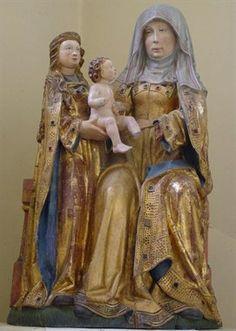 Statue de Sainte Anne Trinitaire Meunier, et Vlecken après lui, attribuent l'origine de ce groupe représentant sainte Anne au couvent des Capucins de Spa, sans toutefois citer de référence. Pierre Lafagne ne mentionne pas ce fait. Paroisse St-Eloi, Becco.
