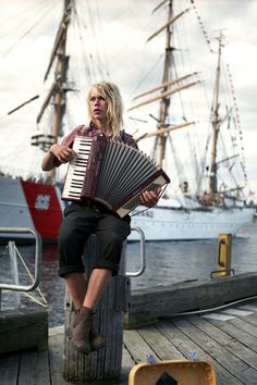 Pinstripes and an accordion on the Halifax Waterfront by KC @KristaComeau (via Fashion East)