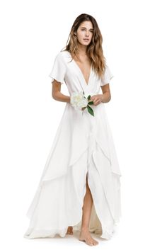 Coordinate your wedding gown's neckline with your bathing suit's straps for perfect pics - sans tan lines.