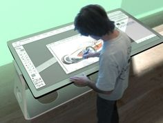 "Designer Michael Powers has devised a drafting table that combines all the designing tools together on its touch sensitive surface. Integrating a 19"" monitor, together with virtual keyboard and mouse on the touchscreen surface, the table comes built in with speakers, markers, tape, rulers, a digital camera, external hard drive, power strip and paper..."