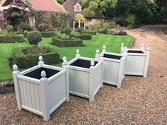 Versailles style planters with acorn finials made from Accoya and painted with French Grey (Farrow & Ball)