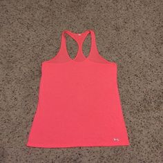 Neon Pink Under Armour  Tank Top Size Medium Under Armour tank top in a bright neon pink color. Size medium. I did cut the tag off but only because it was super itchy the few times o dos wear it! Great condition. Prefect for working out, it is nice and light weight! Under Armour Tops Tank Tops