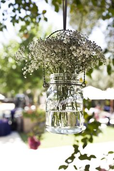 hanging mason jars with babys breath, would look great for a rustic outdoor wedding Hanging Flower Arrangements, Floral Arrangements, Hanging Flowers, Hanging Mason Jars, Theme Color, Jar Crafts, Bottle Crafts, Vineyard Wedding, Crochet Flowers