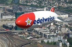 Edelweiss setzt wieder Zeppelin ein von Falk Werner · http://reisefm.de/luftfahrt/edelweiss-luftschiff/ · Die Schweizer Fluggesellschaft Edelweiss Air feiert ihren 20. Geburtstag mit Zeppelin-Flügen über der Schweiz.