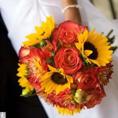 bouquet of sunflowers, roses, and painted fuji mums