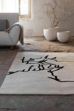 Handmade 100% New Zealand wool rug featuring artwork by Eduardo Chillida.