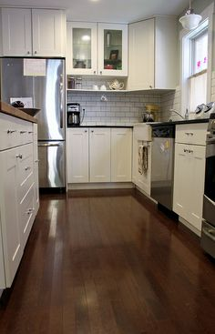 Another Ikea kitchen, with my fave white cabinets/wood floor combo (+one wood counter + black counters + subway tile!)