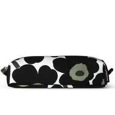 Marimekko's Iconic Unikko design by Maija & Kritina Isola adorns this slim, compact make up bag. In classic black & white this cotton make up bag is perfect for holding make up, jewellery, any bits & bobs easily., in your handbag, on your travels or in the bathroom. It has a PVC coated interior for easy cleaning and a secure zip to keep your essentials safe. It would also make a great pencil case too. If you love contemporary flower prints then this is the perfect make up pencils & more.