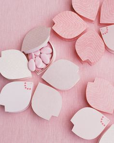 It doesn't get any easier (or cuter) than this. Put dragees in notched-petal favor boxes. Arrange five of these unusual shapes together in a circle, and voila, you've got a classic five-petaled cherry blossom.