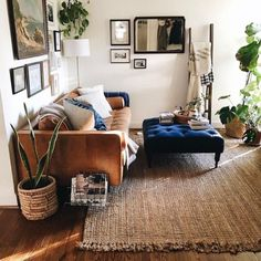 Love the huge ottoman, with lush fabric mixed with rustic rug and masculine couch!