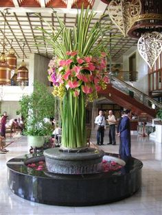 FOYER: oversized grand entrance floral arrangement of hala leaves, anthurium, ...: