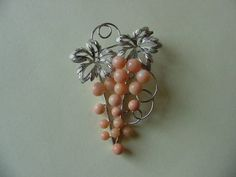 Sterling silver and angel skin coral beads grape cluster pin dating to the 1950s-1960s era