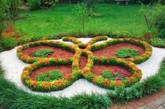 Twelve Butterfly Inspired Designs for your Garden- raised bed with gravel path