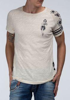 Camiseta en algodón flamé con cuello redondo y estampado all over.