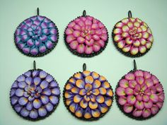 Flower pendants by polymerclaybeads, via Flickr
